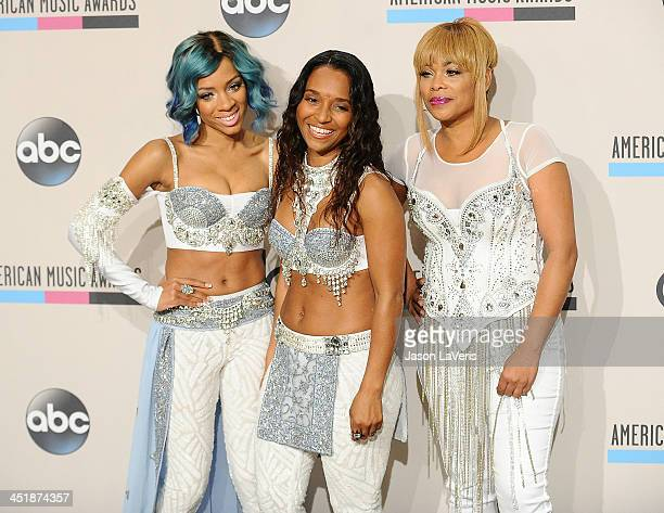 Singers Lil Mama and TLC's Rozonda 'Chilli' Thomas and Tionne 'TBoz' Watkins pose in the press room at the 2013 American Music Awards at Nokia...