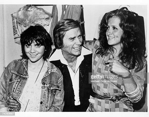 Singers Linda Ronstadt and Bonnie Raitt join country star George Jones backstage at the Bottom Line in September 1980 in New York City New York