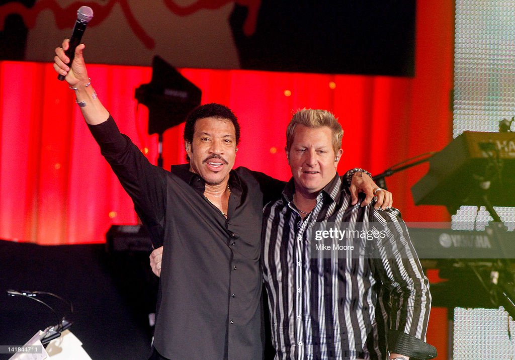 Singers Lionel Richie (L) and Gary Levox perform onstage during Muhammad Ali's Celebrity Fight Night XVIII held at JW Marriott Desert Ridge Resort & Spa on March 24, 2012 in Phoenix, Arizona.