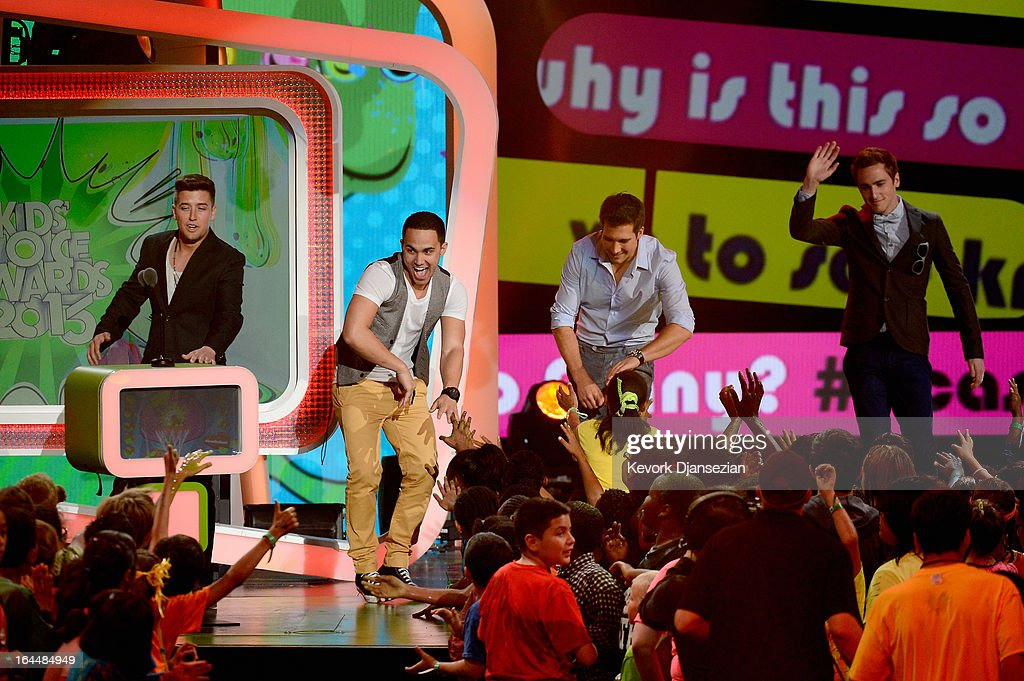 Singers Logan Henderson, Carlos Pena Jr., James Maslow and Kendall Schmidt of Big Time Rush walk onstage during Nickelodeon's 26th Annual Kids' Choice Awards at USC Galen Center on March 23, 2013 in Los Angeles, California.