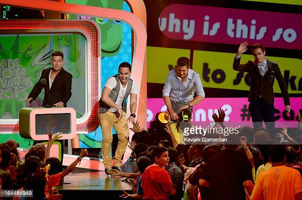 Singers Logan Henderson Carlos Pena Jr James Maslow and Kendall Schmidt of Big Time Rush walk onstage during Nickelodeon's 26th Annual Kids' Choice...