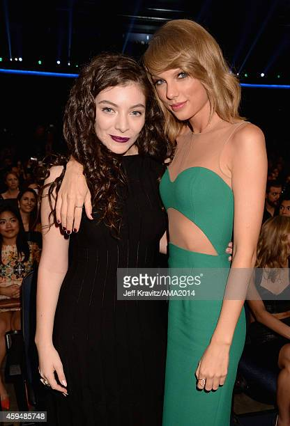 Singers Lorde and Taylor Swift attend the 2014 American Music Awards at Nokia Theatre LA Live on November 23 2014 in Los Angeles California