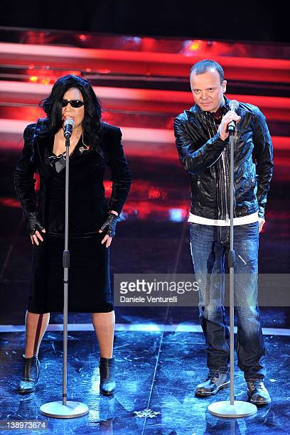 Singers Loredana Berte and Gigi D'Alessio performs on stage at the opening night of the 62th Sanremo Song Festival at the Ariston Theatre on February...