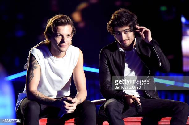 Singers Louis Tomlinson and Zayn Malik of One Direction perform onstage during the One Direction Where We Are Tour at Rose Bowl on September 11 2014...