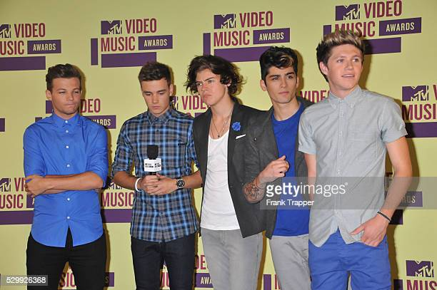 Singers Louis Tomlinson Liam Payne Harry Styles Zayn Malik and Niall Horan of One Direction pose with their Best Pop Video and Best New Artist awards...