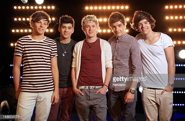 Singers Louis Tomlinson Zayn Malik Niall Horan Liam Payne and Harry Styles of British boy band 'One Direction' pose during a portrait shoot at Fox...