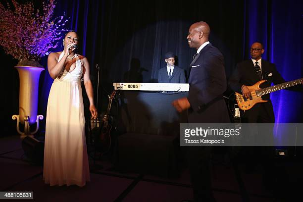 Singers L'Renee and KEM perform at the 2014 Steve Marjorie Harvey Foundation Gala presented by CocaCola at the Hilton Chicago on May 3 2014 in...