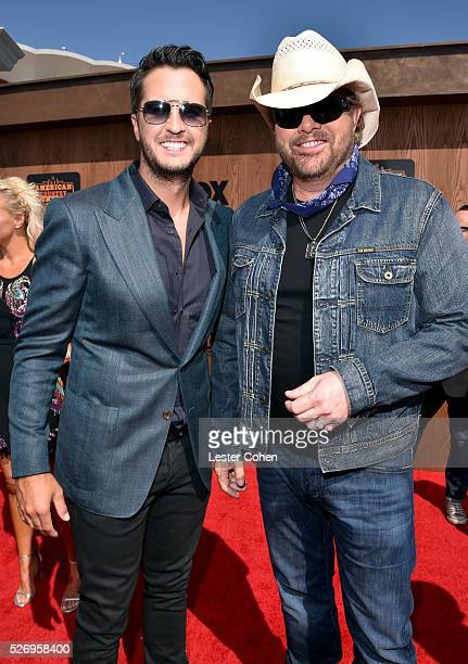 Singers Luke Bryan and Toby Keith attend the 2016 American Country Countdown Awards at The Forum on May 1 2016 in Inglewood California