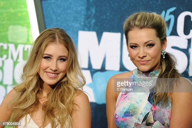 Singers Maddie Marlow and Tae Dye of Maddie and Tae attend the 2015 CMT Music awards at the Bridgestone Arena on June 10 2015 in Nashville Tennessee
