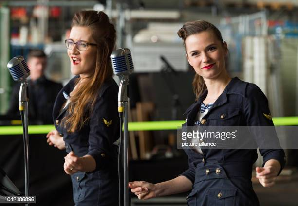 Singers Madeleine Haipt and Juliane Maria Wolff sing in front of a historic Junkers Ju 52 aircraft in a hangar in Hamburg Germany 6 April 2017 The...