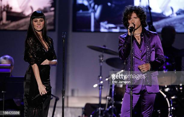 Singers Mala Rodriguez and Enrique Bunbury perform onstage during the 2012 Latin Recording Academy Person Of The Year honoring Caetano Veloso at the...