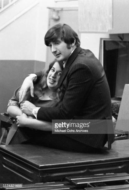 Singers Mama Cass Elliot and Denny Doherty in the studio in a photo shoot for Esquire on December 8 1966 in New York