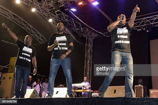 Singers Manadja A'salfo and Goude of the Ivorian band Magic System perform on stage on December 11 2015 at the Obelisque square in Dakar during a...