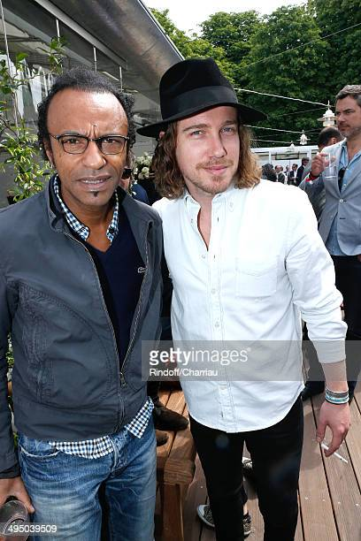 Singers Manu Katche and Julien Dore attend the Roland Garros French Tennis Open 2014 Day 8 on June 1 2014 in Paris France