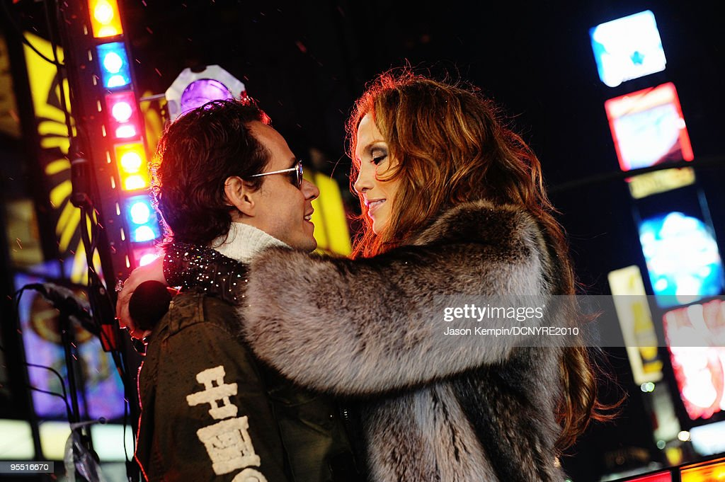 Singers Marc Anthony (L) and Jennifer Lopez celebrate onstage during Dick Clark's New Year's Rockin' Eve With Ryan Seacrest 2010 in Times Square on December 31, 2009 in New York City.