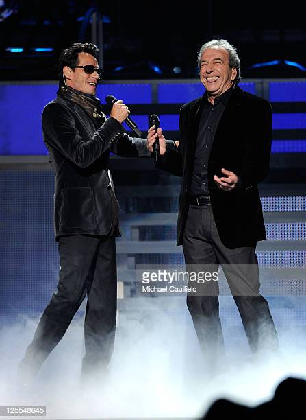 Singers Marc Anthony and Jose Luis Perales perform onstage at the 11th Annual Latin GRAMMY Awards held at the Mandalay Bay Events Center on November...