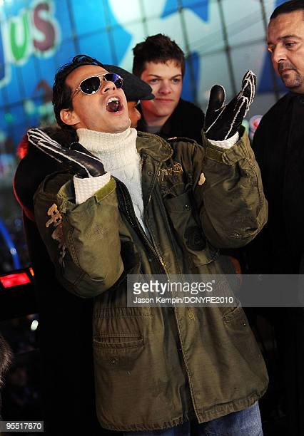 Singers Marc Anthony celebrates onstage during Dick Clark's New Year's Rockin' Eve With Ryan Seacrest 2010 in Times Square on December 31 2009 in New...