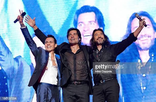 Singers Marc Anthony, Chayanne, and Marco Antonio Solis perform at Izod Center on August 10, 2012 in East Rutherford, New Jersey.