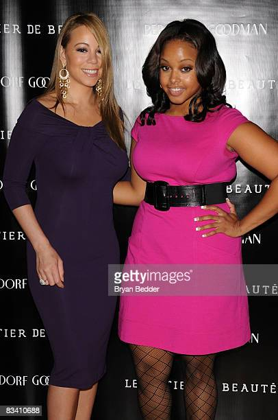 Singers Mariah Carey and Chrisette Michele attends the launch of Le Metier De Beaute cosmetics at Bergdorf Goodman on October 23 2008 in New York City