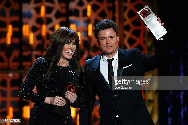 Singers Marie Osmond and Donny Osmond accept the Pop Culture Award onstage during the 2015 TV Land Awards at Saban Theatre on April 11 2015 in...
