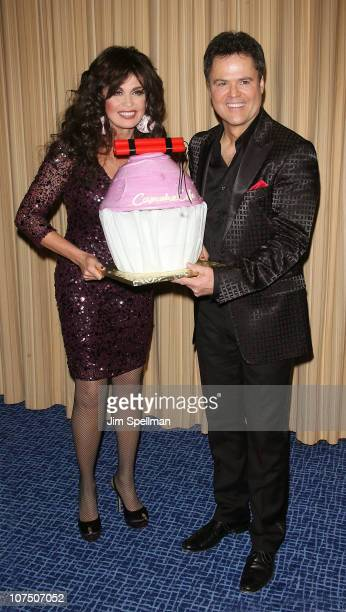 Singers Marie Osmond and Donny Osmond attend the opening night of Donny Marie A Broadway Christmas at the Marriott Marquis Theater on December 9 2010...