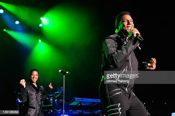 Singers Marlon Jackson and Jermaine Jackson of The Jacksons perform live at The Greek Theatre on July 22 2012 in Los Angeles California