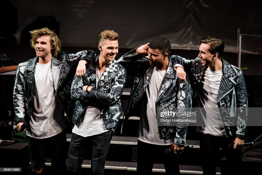 Singers Martijn Stoffers, Karsten Walter, Dominique Bircan Baltas and Sebastian Wurth of boygroup Feuerherz perform live on stage during a concert as support for Maite Kelly at Friedrichstadtpalast on March 13, 2017 in Berlin, Germany.