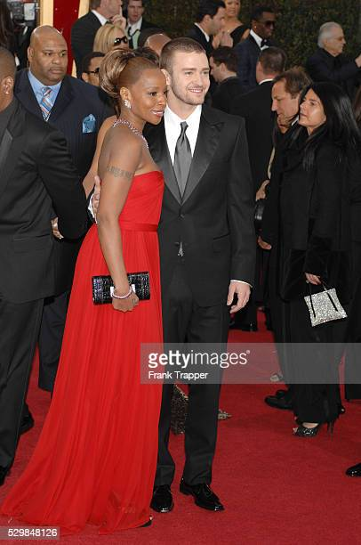 Singers Mary J Blige and Justin Timberlake arrive at the 64th annual Golden Globe Awards held at the Beverly Hilton Hotel Dress by Reem Acra