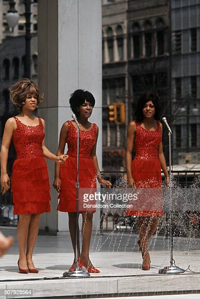 Singers Mary Wilson Florence Ballard and Diana Ross of the R and B Group 'The Supremes' perform on a TV show in 1965 in Detroit Michigan