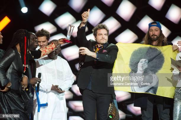 Singers Matthieu Chedid aka M Toumani and Sidiki Diabate and Fatoumata Diawara receive the 'Album de Musiques du Monde' award during the 33rd 'Les...
