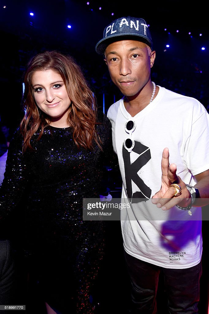 Singers Meghan Trainor (L) and Pharrell Williams pose backstage at the iHeartRadio Music Awards which broadcasted live on TBS, TNT, AND TRUTV from The Forum on April 3, 2016 in Inglewood, California.
