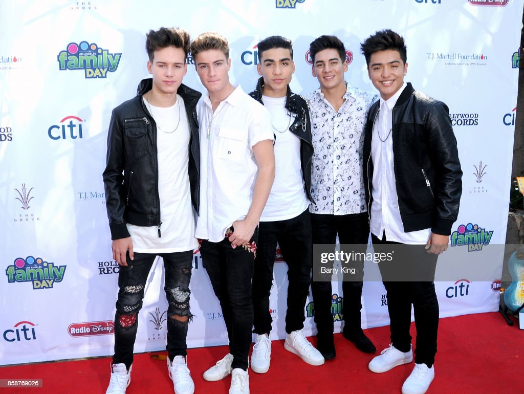 Singers Michael Conor, Brady Tutton, Drew Ramos, Chance Perez and Sergio Calderon of boy band In Real Life attend T.J. Martell Foundation Family Day at The Grove on October 7, 2017 in Los Angeles, California.