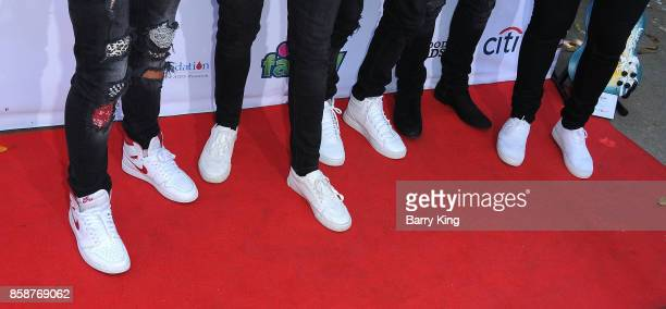 Singers Michael Conor Brady Tutton Drew Ramos Chance Perez and Sergio Calderon of boy band In Real Life shoe detail attend TJ Martell Foundation...