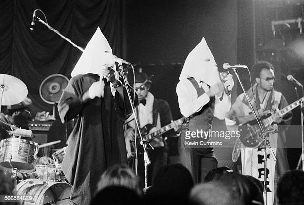Singers Michael Riley and David Hinds performing in Ku Klux Klan hoods with English roots reggae band Steel Pulse at the Elizabethan Hall Belle Vue...