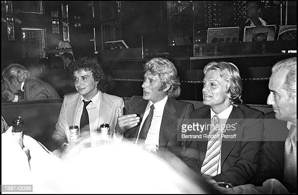 Singers Michel Sardou Johnny Hallyday and Claude Francois during a party at Elysee Matignon night club in Paris