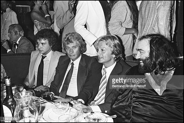Singers Michel Sardou Johnny Hallyday Demis Roussos and Claude Francois during a party at Elysee Matignon night club in Paris