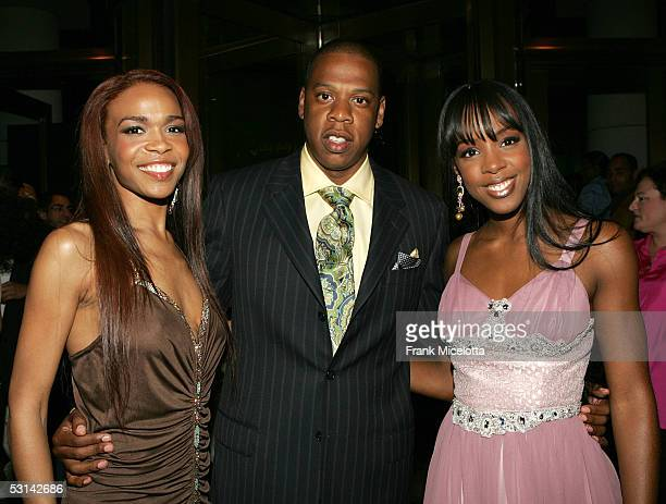 Singers Michelle Williams and Kelly Rowland of Destiny's Child pose with JayZ at the Beyonce Beyond the Red Carpet auction presented by Beyonce and...