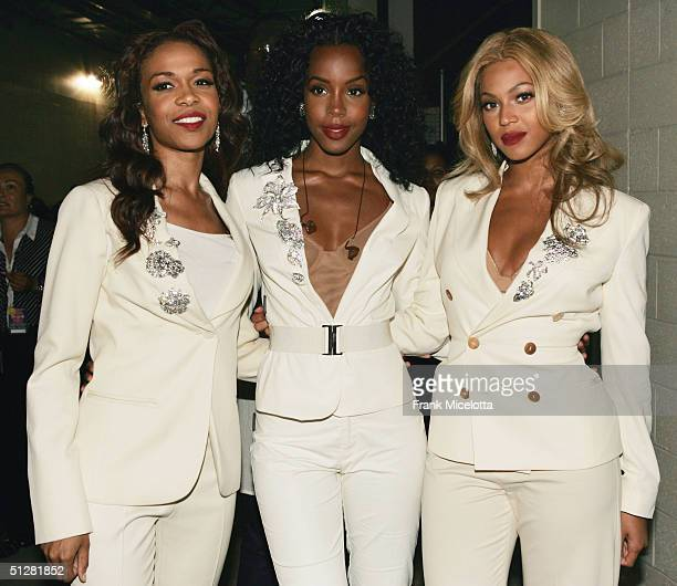 Singers Michelle Williams Kelly Rowland and Beyonce Knowles of Destiny's Child pose backstage before the NFL opening game between the Indianapolis...