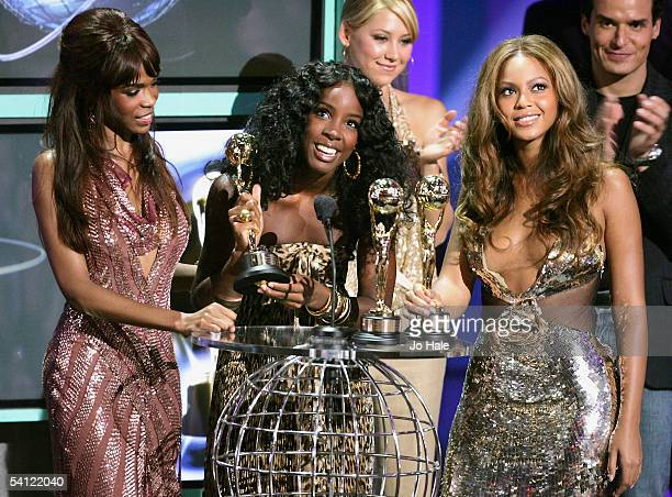 Singers Michelle Williams Kelly Rowland and Beyonce Knowles of Destiny's Child receive the award for Best Selling Female Group Of All Time as former...