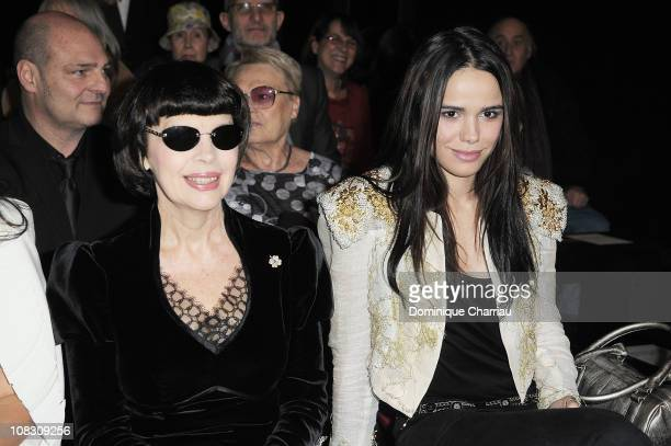 Singers Mireille Mathieu and Melissa Mars attend the Stephane Rolland show as part of the Paris Haute Couture Fashion Week Spring/Summer 2011 at...