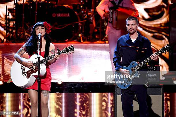 Singers Mon Laferte and Juanes perform onstage during The 17th Annual Latin Grammy Awards at TMobile Arena on November 17 2016 in Las Vegas Nevada