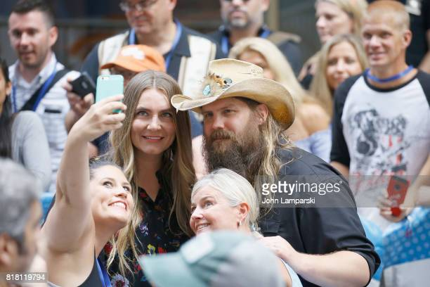 Singers Morgane Stapleton and Chris Stapleton pose for a selfie with fans on NBC's 'Today' at Rockefeller Plaza on July 18 2017 in New York City