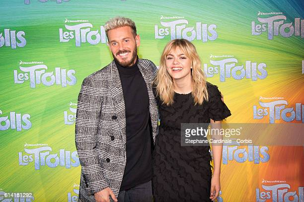 """Singers M.Pokora and Louane Emera attends the """"Les Trolls"""" Paris Premiere at Le Grand Rex on October 12, 2016 in Paris, France."""