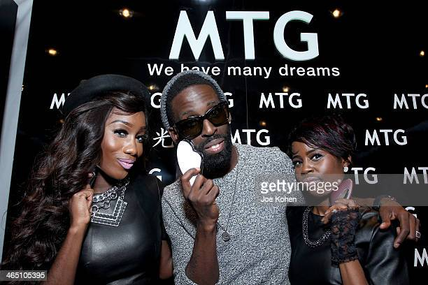 Singers Mumen Ngenge Tye Tribbett and DeMaris Toy attend the GRAMMY Gift Lounge during the 56th Grammy Awards at Staples Center on January 25 2014 in...