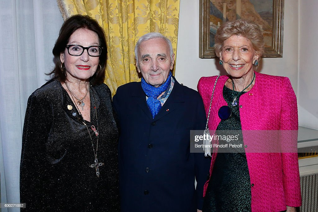Singers Nana Mouskouri, Charles Aznavour and Permanent Secretary of 'Academie Francaise' Helene Carrere d'Encausse attend Nana Mouskouri gives the Greek Prize 'Nikos Gatsos 2016' to Charles Aznavour at Embassy of Greece on December 19, 2016 in Paris, France.