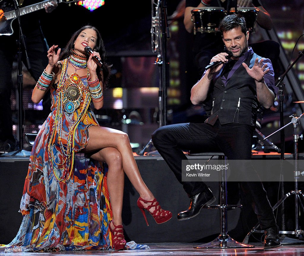 Singers Natalia Jimenez (L) and Ricky Martin perform onstage during the 11th annual Latin GRAMMY Awards at the Mandalay Bay Events Center on November 11, 2010 in Las Vegas, Nevada.