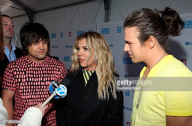 Singers Neil Perry Kimberly Perry and Reid Perry from the group The Band Perry are interviewed on the red carpet during 'We Day' at the Allstate...
