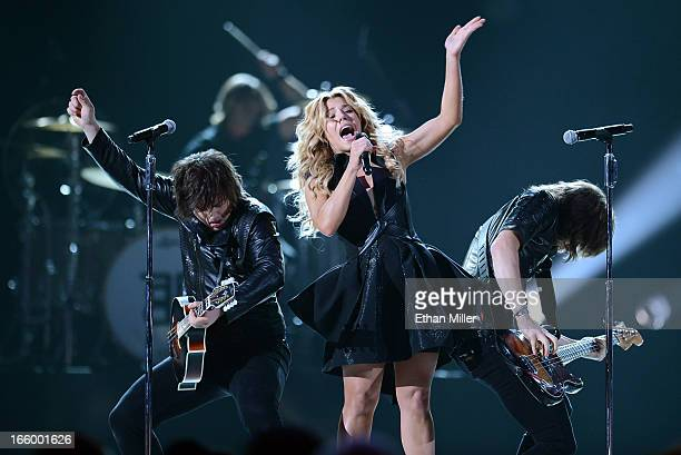 Singers Neil Perry Kimberly Perry and Reid Perry of The Band Perry perform onstage during the 48th Annual Academy of Country Music Awards at the MGM...