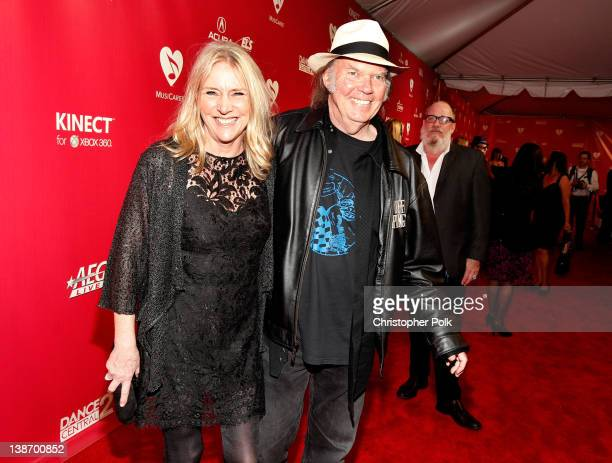 Singers Neil Young and Pegi Young arrive at The 2012 MusiCares Person of The Year Gala Honoring Paul McCartney at Los Angeles Convention Center on...
