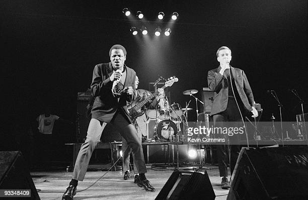 Singers Neville Staple and Terry Hall of English ska band The Specials perform on stage at the Apollo in Manchester on November 01 1979
